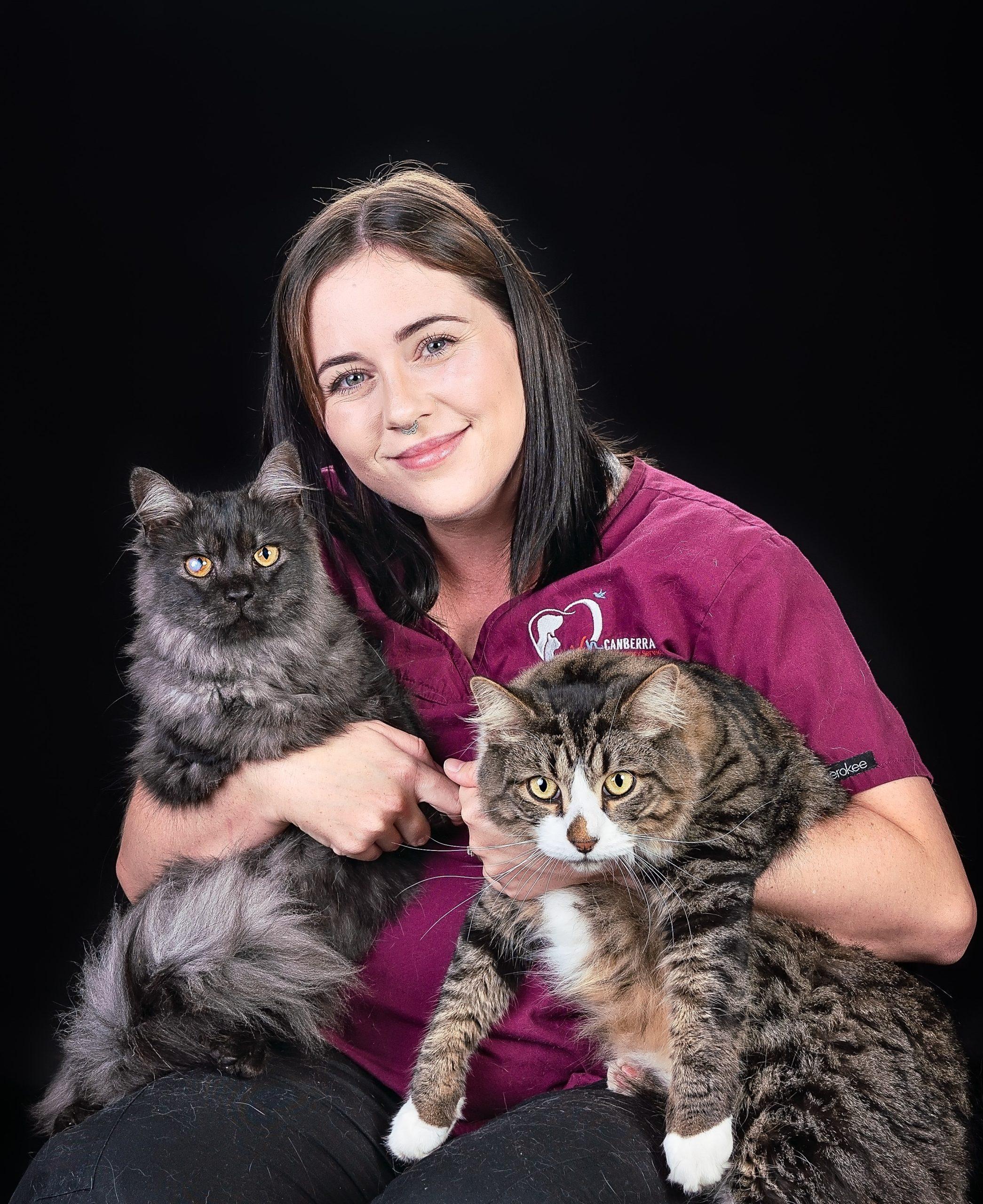 Vet Nurse Skye holding 2 cats